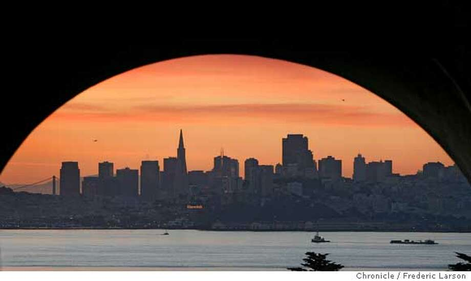 """{object name} """"Planet San Francisco,"""" a break in the foul weather as the city takes on another look of crisp clear blue skies. An arch tunnel on Bunker Road leading into Fort Baker helped San Francisco skyline at day break take on worldly appearance. Date: 3/8/06; Just before daybreak at 6:20:57 AM  I shot this photograph with a Canon EOS-1D Mark II lens (mm): 145, ISO: 400, aperture: 2.8, shutter: 1/160, programed at, shutter priority. 3/8/06  Frederic Larson Photo: Frederic Larson"""