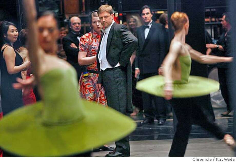 WEST11_0094_KW_.jpg On 1/26/06 in San Francisco the San Francisco Ballet's new orchestra conductor, Martin West, 37,(CENTER) back stage while dancers warm-up for opening night performance of the San Francisco Ballet titled Reflections.  Kat Wade/The Chronicle Mandatory Credit for San Francisco Chronicle and photographer, Kat Wade, Mags out Photo: Kat Wade