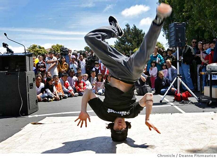 library_0014_df.jpg  Jonathan Suquitan, 22, a member of Jive Core Legion was B-Boying to entertain the crowd. Mayor Gavin Newsom and other officials were on hand for the ground breaking of the new Portola Branch Library. Photographed in San Francisco on 7/17/07. Deanne Fitzmaurice / The Chronicle Mandatory credit for photographer and San Francisco Chronicle. No Sales/Magazines out. Photo: Deanne Fitzmaurice