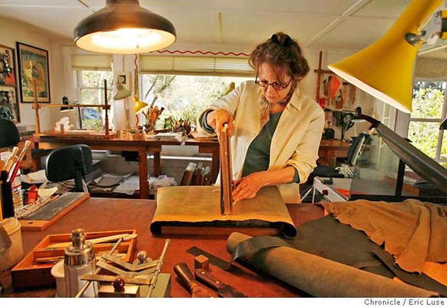 .JPG  Eleanore Ramsey, hand bookbinder in her Sausalito studio. She is working on the leather to be bound to the cover of this book for a client. Photographer:  Eric Luse / The Chronicle names (cq) from source  Eleanore Ramsey MANDATORY CREDIT FOR PHOTOG AND SF CHRONICLE/NO SALES-MAGS OUT Photo: Eric Luse