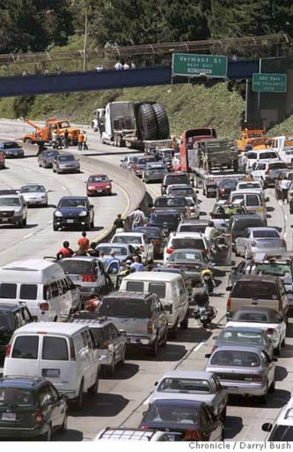 Traffic on Hwy. 101 North (seen north from 23rd Street) is delayed as workers clear giant tires that were spilled in an accident late Friday afternoon in San Francisco, CA on Friday, June 16, 2006. shot: 6/16/06  Darryl Bush / The Chronicle ** (cq) Photo: Darryl Bush