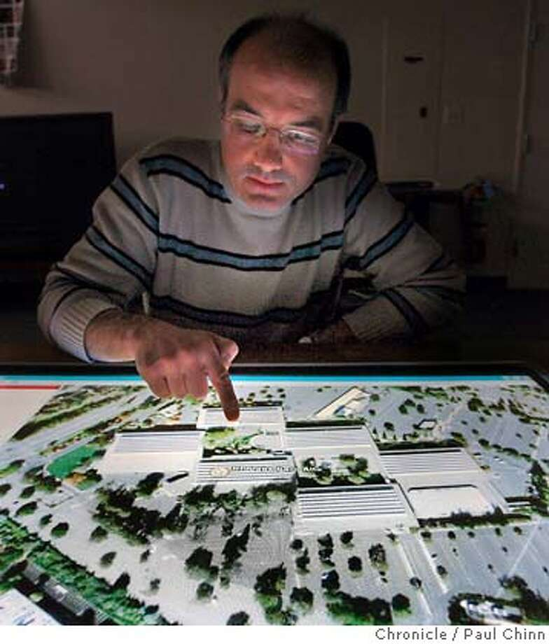 Pere Obrador displays a Google Earth map image of HP Labs on the prototype Misto coffee table touch-screen computer. Engineers at HP Labs demonstrated several projects in development to mark the technology giant's 40th anniversary in Palo Alto, Calif. on 2/21/06.  PAUL CHINN/The Chronicle MANDATORY CREDIT FOR PHOTOG AND S.F. CHRONICLE/ - MAGS OUT Photo: PAUL CHINN