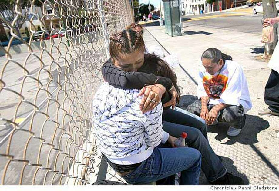 Santillan_125_PG.JPG  (no last names) at left, friends of Santillan hug each other. They are Jennifer, a friend of his since 6th grade, & Angela. Oscar Roman age 17, kneels at memorial at right. His friends hold a memorial in tribute to him outside the North Beach Playground where he fell, fatallly wounded.  Jose Santillan, a 19-year-old star soccer player was fatally stabbed in the back on a busy street after getting off a bus near his North Beach home in San Francisco. Event on 7/3/07 in San Francisco.  Penni Gladstone / The Chronicle  Ran on: 07-04-2007  Jennifer and Angela, friends of Jose Santillan, the soccer player stabbed to death in North Beach, hug Tuesday as Oscar Roman, 17, kneels at a memorial outside the North Beach Playground where Santillan fell. Supporters of the family are asking for help to pay for funeral and burial costs. A memorial service is planned for 9 a.m. Friday at St. Charles Borromeo Church at 713 S. Van Ness Ave. Donations should go to the Santillan Family Trust at the Washington Mutual branch at 1201 Market St.  Ran on: 07-04-2007 Ran on: 07-04-2007 Photo: Penni Gladstone