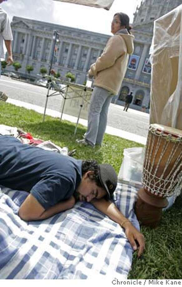 DREAM04_315_MBK.JPG Nineteen-year-old and Cal Berkeley student Rodrigo (declined to give last name) rests during a day of fasting at Civic Center Plaza San Francisco, CA, on Tuesday, July, 3, 2007. Rodrigo and other students, including Miriam (no last name given), are fasting this week to advocate the Dream Act, a provision that would enable foreign-born children of undocumented immigrants to pursue higher education. Thursday fasters and supporters from around the state will converge in San Francisco for a march and vigil. photo taken: 7/3/07  Mike Kane / The Chronicle *Miriam, Rodrigo MANDATORY CREDIT FOR PHOTOG AND SF CHRONICLE/NO SALES-MAGS OUT Photo: MIKE KANE