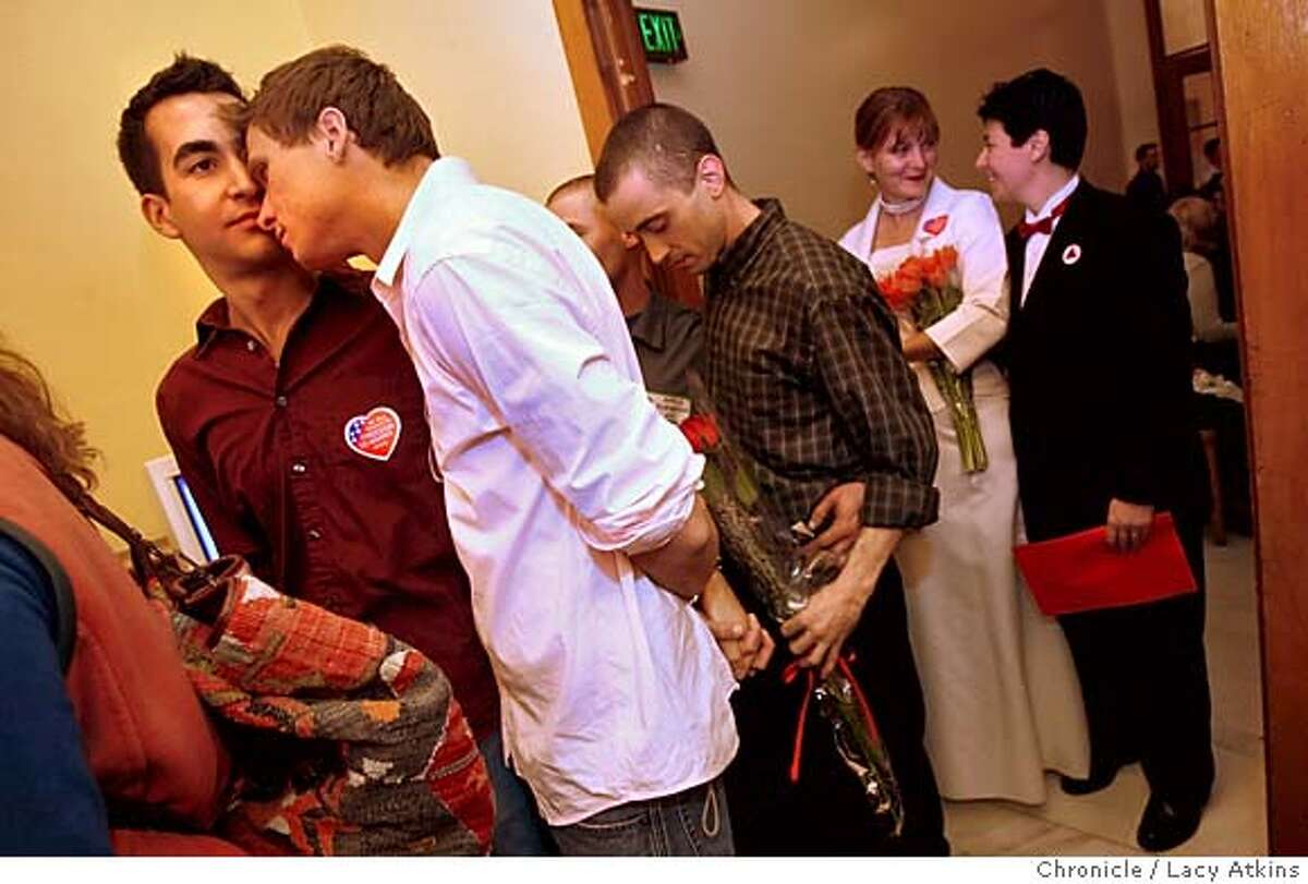 Kelly Woyewodzic, right, nuzzles up to his partner Steven Azar after hearing that the gay couples in front of them were being denied marriage license at San Francisco's City Hall, Feb. 14, 2006. They were among the couples that gathered in hopes to marry on Valentines Day. Gay and Lesbian couple go the City Hall in hopes to get married on Valentines Day, but were denied the right, Feb. 14, 2006, in San Francisco. Photographer:Atkins, Lacy MANDATORY CREDIT FOR PHOTOG AND SF CHRONICLE/ -MAGS OUT