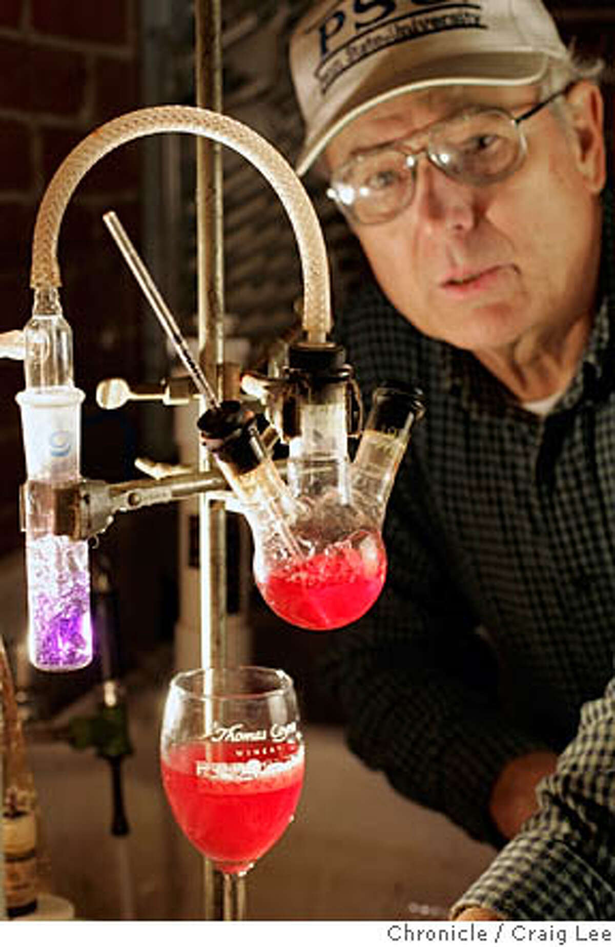 ACID16_885_cl.JPG Photo of Thomas Coyne, proprietor of his eponymous winery in Livermore. He is a chemical engineer who worked at Clorox. This is for a story on acid testing in wine. Photo of Thomas Coyne with a SO 2 Aspirator (the 2 needs to be lower case), which measure the free sulfur dioxide in wine. That is rose wine he is testing. Craig Lee / The Chronicle MANDATORY CREDIT FOR PHOTOG AND SF CHRONICLE/ -MAGS OUT