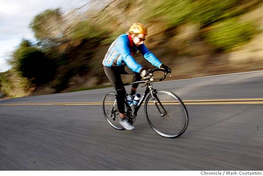 BIKETOWNS_0037  {2/16/06} A BICYCLIST RIDES REDWOOD ROAD, PART OF THE COURSE FOR THE RACE ON SUNDAY. ADVANCE FOR BIG BIKE RACE THIS SUNDAY. EVENT ON 2/16/06 IN RURAL ALAMEDA COUNTY. PHOTO: MARK COSTANTINI/SAN FRANCISCO CHRONICLE Photo: MARK COSTANTINI
