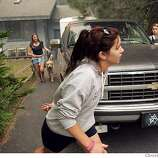 Meg Peart, Lauren Marlak (middle), and Jenna Doyle evacutate there home along Gardner St., Tuesday June 26, 2007, in South Lake Tahoe, Ca. (Lacy Atkins / San Francisco Chronicle) Ran on: 06-27-2007  EVACUATION: Meg Peart, Lauren Marlak and Jenna Doyle prepare to leave their home in the fire area.  Ran on: 06-27-2007  EVACUATION: Meg Peart, Lauren Marlak and Jenna Doyle prepare to leave their home in the fire area.  Ran on: 06-27-2007  EVACUATION: Meg Peart (left), Lauren Marlak and Jenna Doyle prepare to flee their Gardner Street home.
