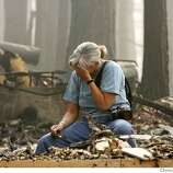 Missy Springer weeps as she looks through the debris for her mothers Royal Dalton China, at her home at 767 Angora Creek, Tuesday June 26, 2007, in Meyers, Ca. (Lacy Atkins /San Francisco Chronicle)  *Missy Springer MANDATORY CREDITFOR PHOTGRAPHER AND SAN FRANCISCO CHRONICLE/NO SALES-MAGS OUT