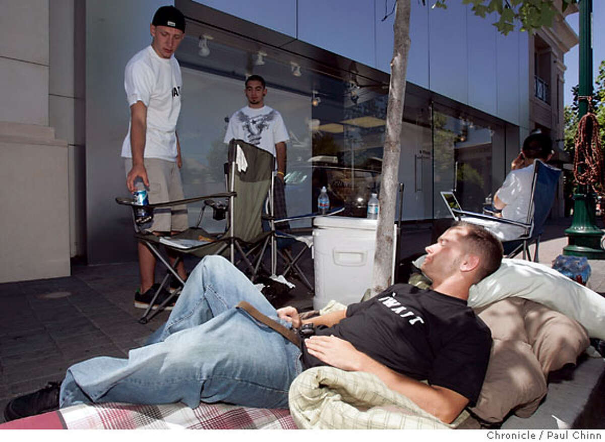Jon May (foreground) and three high school buddies from Benicia were the first in line to buy the highly anticipated iPhone in Walnut Creek, Calif. on Wednesday, June 27, 2007 when it goes on sale Friday at the Apple Store. The group arrived at 5 a.m. and hopes to sell the first two spots in line and then purchase up to five iPhones to sell on eBay and earn money for college. PAUL CHINN/The Chronicle **Jon May
