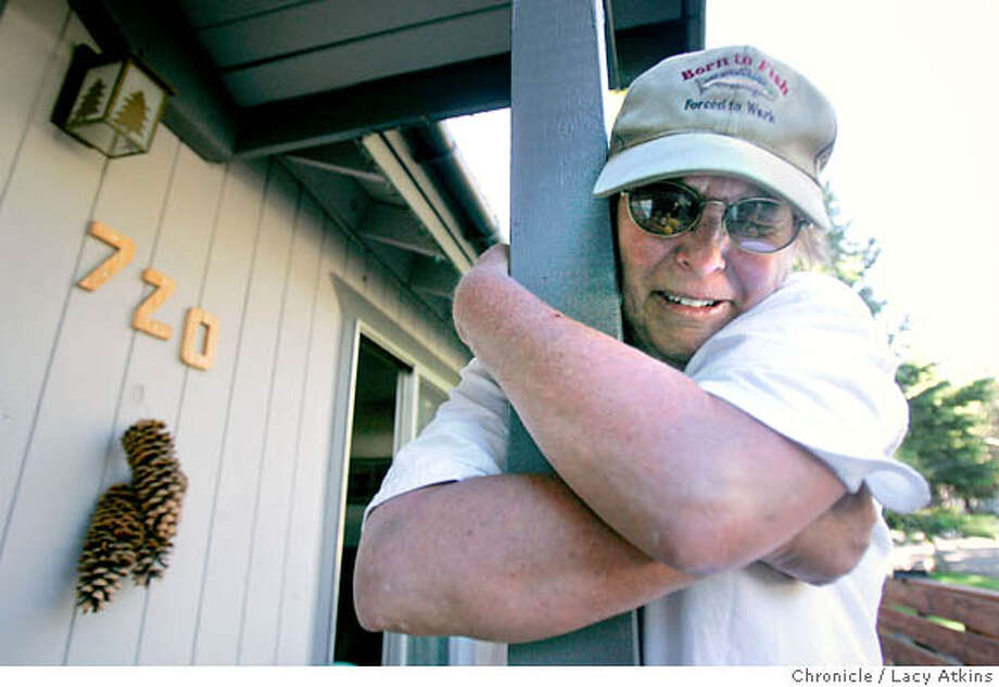 Francine Tanner hugs her home as she cries after returning home for the first time in unincorporated Tahoe Paradise, Thursday June 28, 2007, in South Lake Tahoe, Ca. (Lacy Atkins /San Francisco Chronicle)  *Francine Tanner Photo: Lacy Atkins