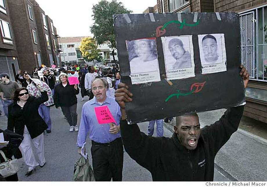 RALLY21_148_mac.jpg Marching through the Friendship Village apartments, 31 year old Malachi Maddox, (right) of San Francisco joins about 200 supporters who made their way around the Western Addition to try and stop the violence. Maddox holds a poster with the pictures of several young men who lost theinr lives on the streets of San Francsico due to violence. Western Addition community members and leaders say they are outraged by a string of 8 shootings within a recent 3-day period, all involving young people 11 to 19 years old. On Wednesday, community members will meet at Fillmore and Eddy for a rally and walk through the neighborhood to demand youth put the guns down and call on parents and guardians to keep closer tabs on their children. Photographed in, San Francisco, Ca, on 6/20/07. Photo by: Michael Macor/ The Chronicle Ran on: 06-21-2007  Adrian Williams (left) and her granddaughter, Jazmine Thorne, 8, rally in the Western Addition. Photo: Michael Macor