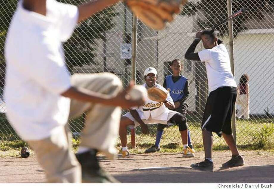 oakkidsbaseball_0009_db.JPG  Na'Sier Ware, 9, pitches foreground, as coach Roscoe Bryant Jr., plays catcher and Justin Robinson, 9, calls balls and strikes, back, as Eddie Heard, 13, readies to swing the bat at batting practice at Lowell Park in West Oakland, in a local baseball program for kids run by Roscoe Bryant Jr. and his wife Lehi Bryant in Oakland, CA, on Thursday, June, 7, 2007. photo taken: 6/7/07  Darryl Bush / The Chronicle ** Na'Sier Ware, Justin Robinson, Eddie Heard, Roscoe Bryant Jr., Lehi Bryant (cq) MANDATORY CREDIT FOR PHOTOG AND SF CHRONICLE/NO SALES-MAGS OUT Photo: Darryl Bush