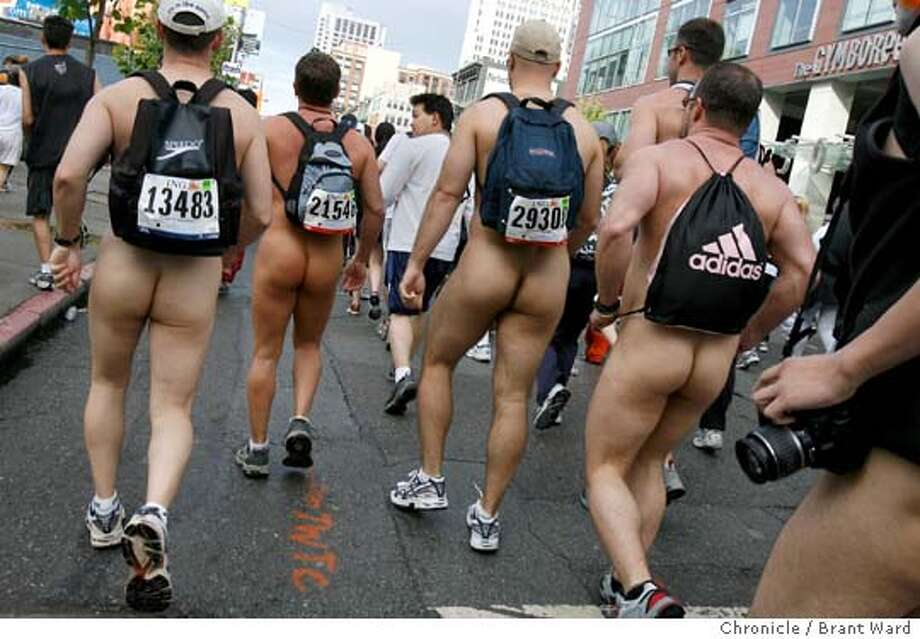 As is tradition at the Bay to Breakers, some individuals chose not to dress for the occasion, like this group of men making their way down Howard Street during the 2006 race. Photo: Brant Ward
