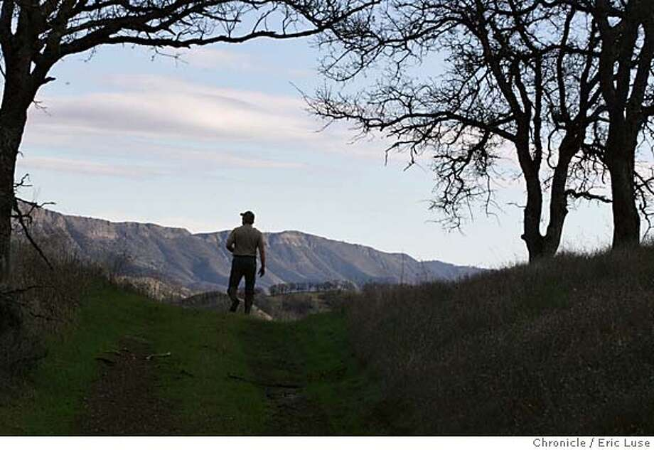 refuge_141_el.JPG  Phil Pridmore, Wildlife Habitats Supervisor, Fish & Game hikes to one of the highest peaks of the property looking West. The Nature Conservancy has just bought a huge ranch in Napa County that provides a critical link with other refuges and protected properties, forming a large corridor of protected wildlife habitat in the North Bay that will be forever protected. this property is essential to a larger plan of providing major conservation values for the coast range from Oregon to SF Bay  Photographer:  Eric Luse / The Chronicle MANDATORY CREDIT FOR PHOTOG AND SF CHRONICLE/ -MAGS OUT Photo: Eric Luse