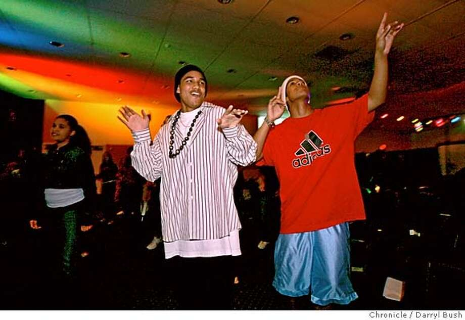 "hiphop_church_0150_db.jpg  David Fiame, 16, of Antioch, left, and his brother Anthony Fiame, 17, of Pittsburg, right, dance to gospel style hip-hop music at a ""Cross Culture Youth"" event at Changed Life Church's event center on Friday night.  Event on 1/6/06 in Pittsburg.  Darryl Bush / The Chronicle MANDATORY CREDIT FOR PHOTOG AND SF CHRONICLE/ -MAGS OUT Photo: Darryl Bush"