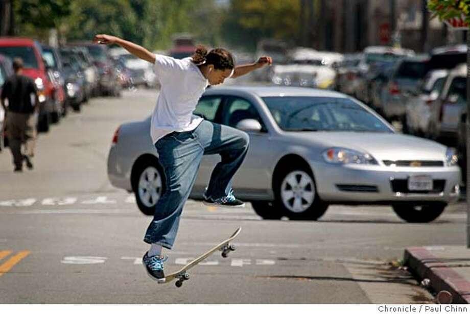 Kossi Konan leaps from his board near a skateboard park under warm sunny skies in Berkeley, Calif. on Tuesday, June 12, 2007.  PAUL CHINN/The Chronicle  **Kossi Konan Photo: PAUL CHINN