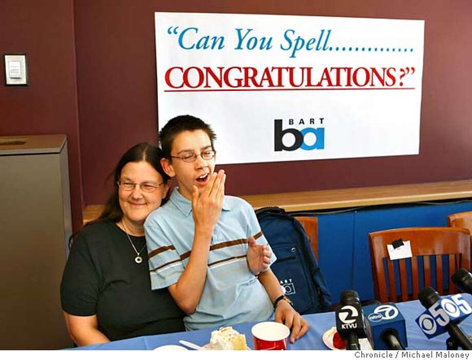 Yawning, a tired Evan O'Dorney relaxes after a press conference on his mom Jennifer O'Dorney's lap..  BART held a welcome home celebration in a private lounge at the Oakland Airport for spelling bee champion Evan O'Dorney who's dad Michael O'Dorney works as a BART train operator. The 2007 Scripps National Spelling Bee champion from Danville arrived in Oakland after a whirl-wind week of media appearances since the spelling bee was held in Washington D.C.  Photo by Michael Maloney / San Francisco Chronicle Photo taken on 6/6/07 in Oakland, CA  ***Evan O'Dorney, Jennifer O'Dorney Photo: Michael Maloney