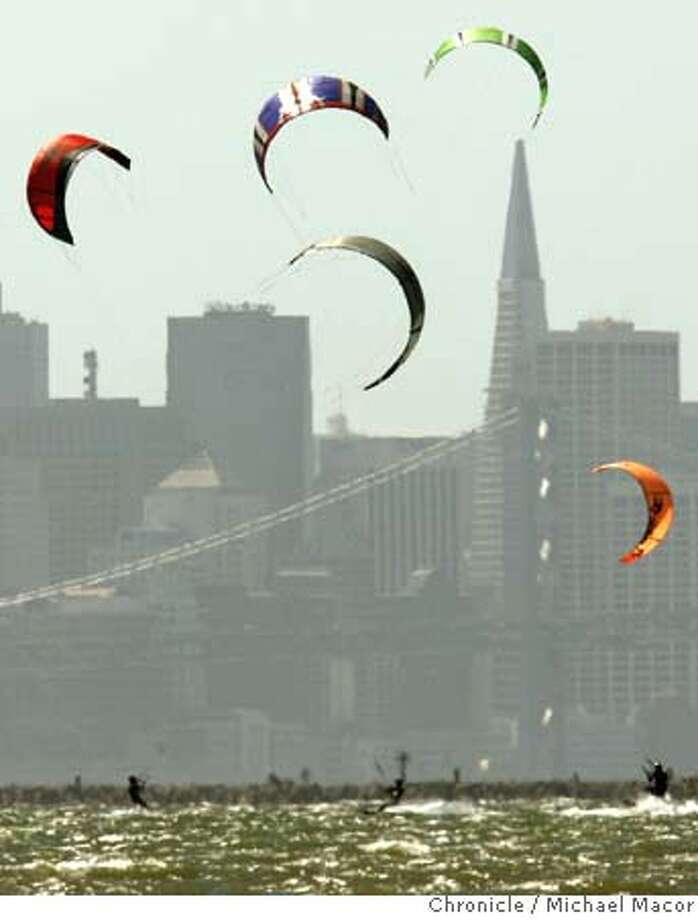 kiteboarders_072_mac.jpg Kiteboarders skip across the waters of San Francisco Bay, taking advantage of the strong steady winds, off Crown Beach in Alameda against the backdrop of the skyline of San Francisco. Photographed in, Alameda, Ca, on 6/6/07. Photo by: Michael Macor/ The Chronicle Mandatory credit for Photographer and San Francisco Chronicle No sales/ Magazines Out Photo: Michael Macor
