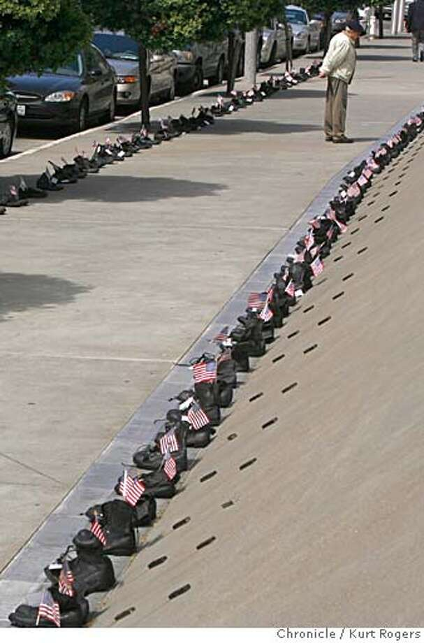 355 pairs of boots line the side walk in front of the Federal Building.The Memorial for Californians who have died in Iraq. was put their by the American Friends Service Committee.  TUESDAY, MAY 29, 2007 KURT ROGERS SAN FRANCISCO SFC  THE CHRONICLE Photo: KURT ROGERS