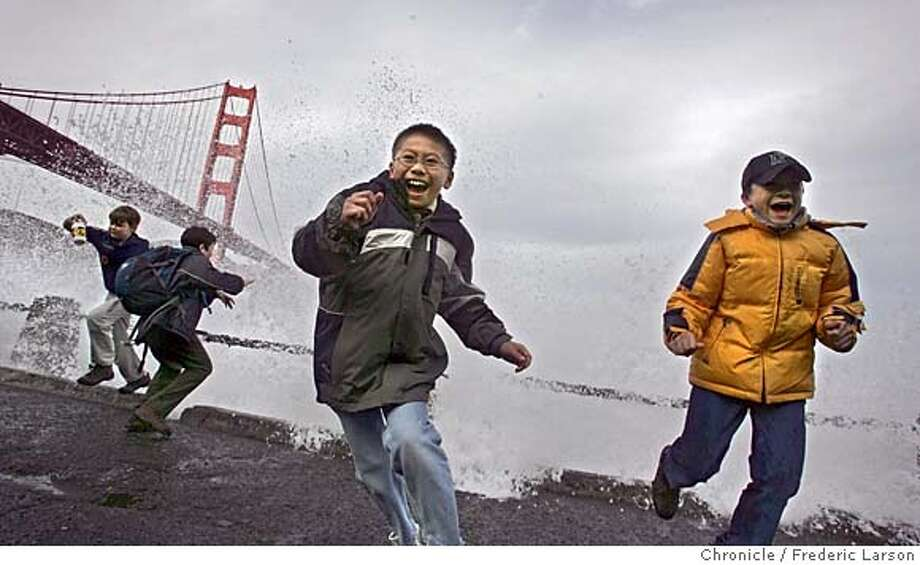 WEATHER_0148_fl.jpg Ryan Young (10) center and his scout mate Jason Martin (10) (right) dodge the high surf at Fort Point under the Golden Gate Bridge during a Boy Scout hike with their troop from Santa Clara. All the boys in the hike found some enjoyment in playing in the high surf hitting the rocks off Fort Point from the recent weather. A brief let up rain forced many outside enjoying the calm before another storm blows in the Bay Area this week.  12/20/05 San Francisco CA Frederic Larson San Francisco Chronicle Photo: Frederic Larson
