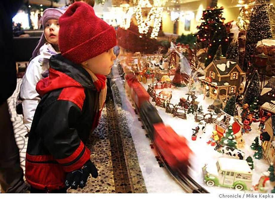miniatures017seqn}_mk.JPG  Eliza Branch, 4, of South Lake Tohoe, CA and Andrew Pallota, 5, of Vallejo watch a miniature train move through one of Connacher's villages.  Len Connacher of Castro Valley has been collecting miniature christmas villages for over 20 years and has been displaying his collection at the Hyatt on Market near Embarcadero for 8 years. San Francisco on date}. Mike Kepka / The Chronicle MANDATORY CREDIT FOR PHOTOG AND SF CHRONICLE/ -MAGS OUT Photo: Mike Kepka