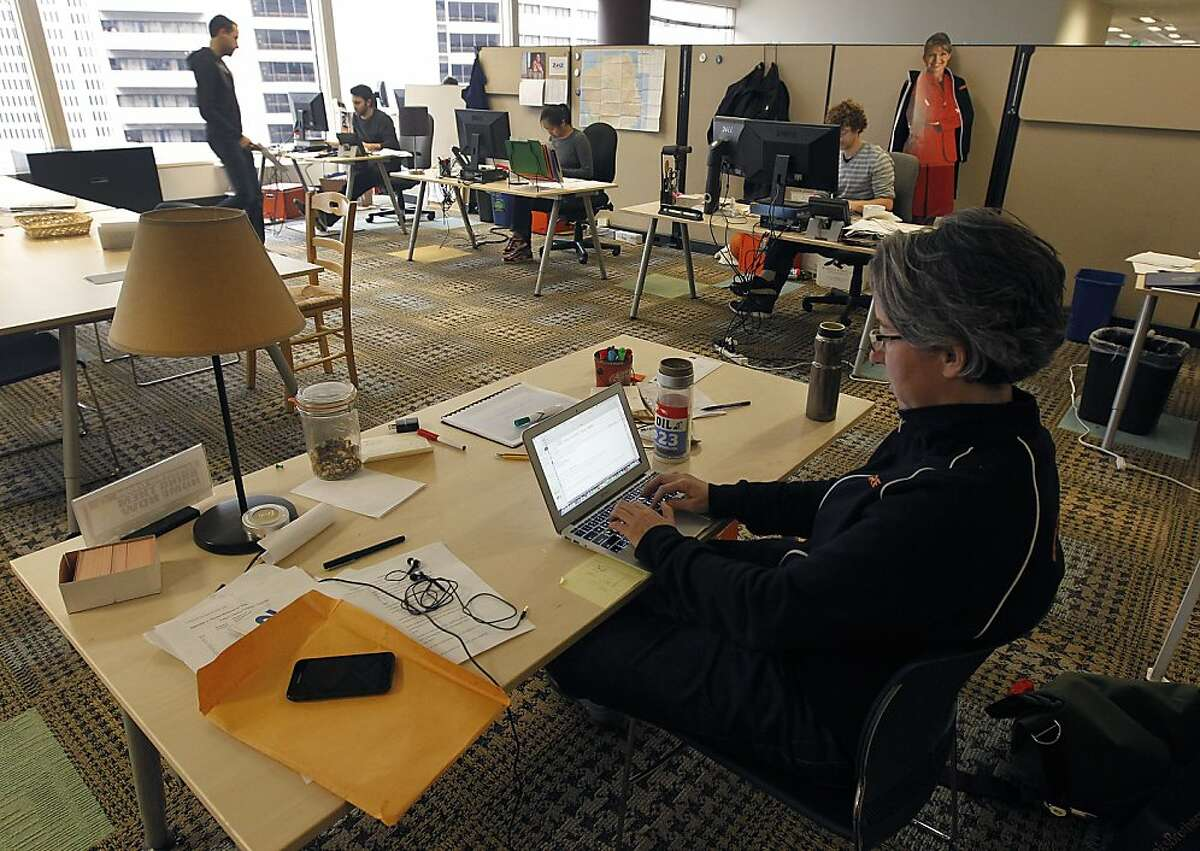Becky Bond works in Credo Mobile's super PAC nerve center in San Francisco, Calif. on Friday. Bond is the political director of the telecommunication firm's newly-formed political action committee which is taking aim at several Tea Party politicians.