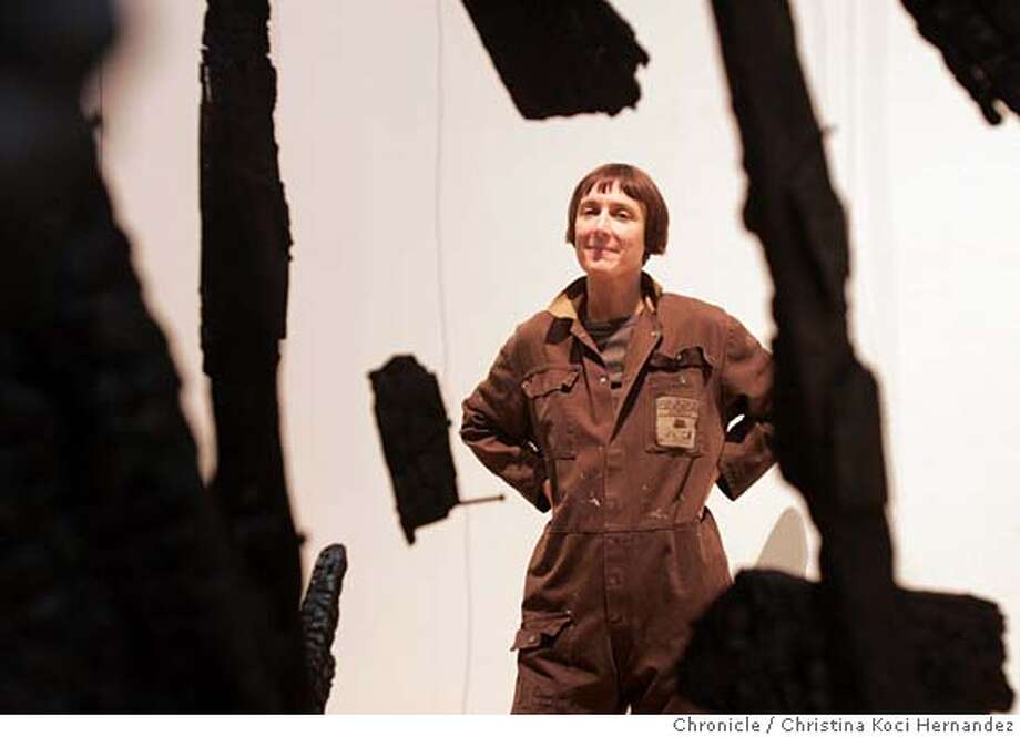 "CHRISTINA KOCI HERNANDEZ/CHRONICLE  Parker shot through her sculpture, ""Anti-Mass.""Sculptor Cornelia Parker in her show,at Yerba Buena Center, for profile. Photo: CHRISTINA KOCI HERNANDEZ"