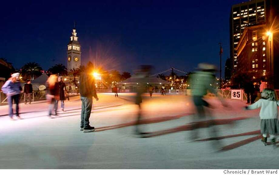 ice025_ward.jpg  With the Ferry building and the lights of the Bay Bridge in the background, ice skaters enjoyed the brisk air and holiday music Monday evening.  The Kristi Yamaguchi Holiday Ice Rink has opened again at the Embarcadero Center. Ice skaters can hit the ice in chilly San Francisco everyday from 10am until 10pm, and 11:30pm on Fridays and Saturdays.12/5/05 Photo: Brant Ward