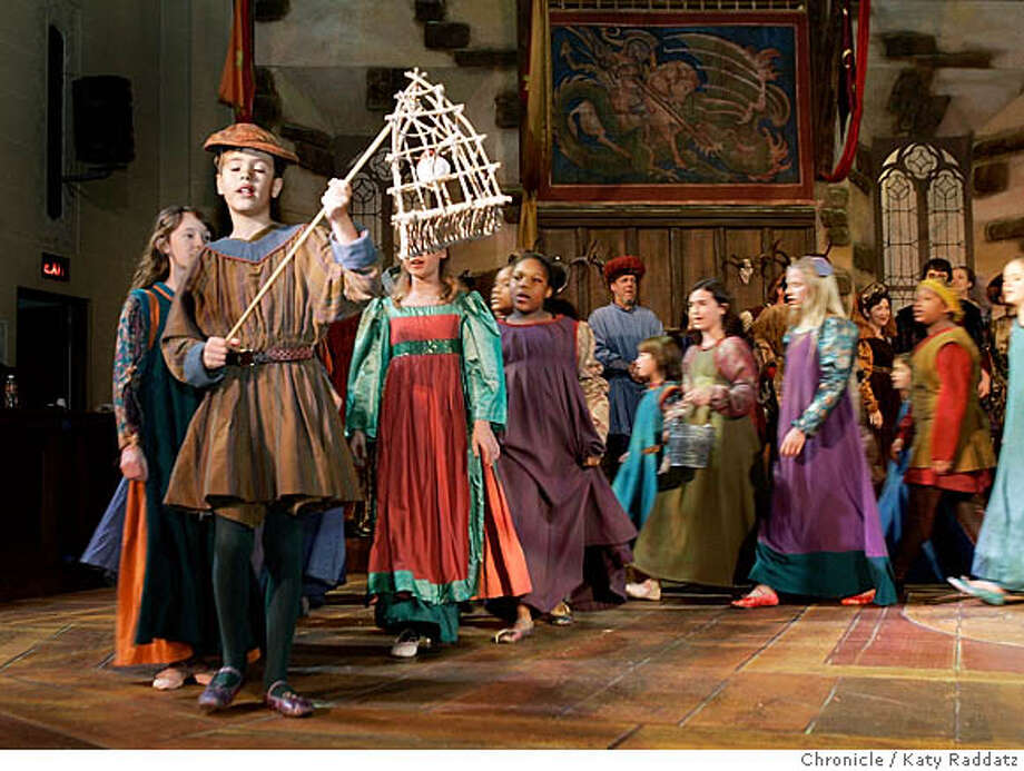 SHOWN: Oliver Konker, age 10, from Berkeley, leads a string of children playing beggars. Oliver brandishes a cage carrying a Christmas Bird from the original Revels twenty years ago. The Christmas Revels, at the Scottish Rite Center in Oakland. We have also shot the auditions for children (Christina Koci Hernandez shot those.) Photo taken on 12/4/05, in OAKLAND, CA.  By Katy Raddatz / The San Francisco Chronicle Photo: Katy Raddatz
