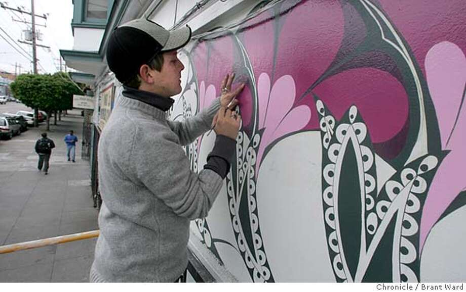 mural032_ward.jpg  Jet Martinez, a professional muralist, works on the collection of Morning Glory flowers that adorn the outside of the All Star Hotel at 16th and Folsom Streets. The hotel will soon be a Care Not Cash hotel and $1000s of dollars are being spent to spruce it up.  12/7/05 Photo: Brant Ward