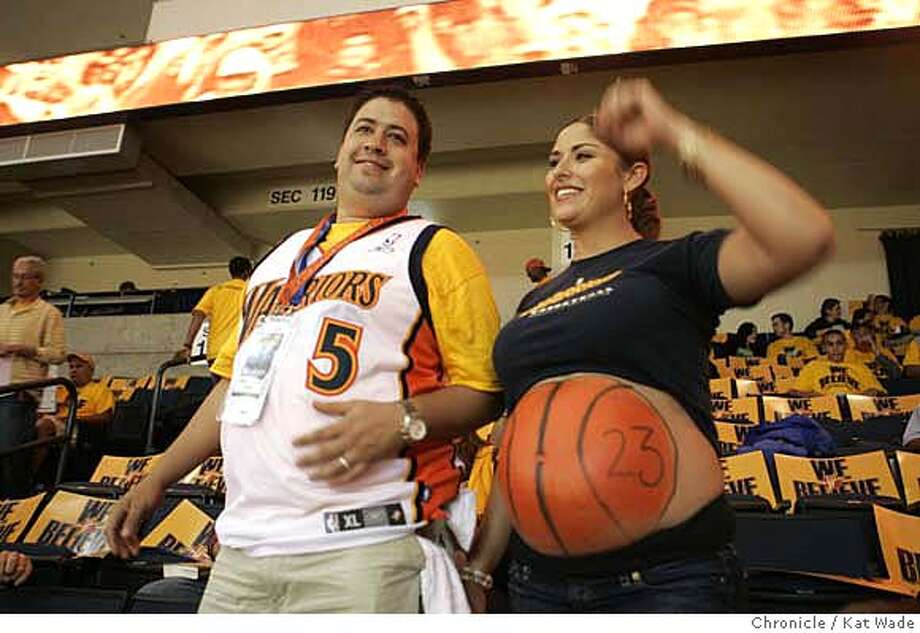 (L to R) with their son due next week David and Alicia Duarte from San Jose got into the spirit by painting her pregnant tummy like a basketball for game 3 against the Dallas Mavericks at Oracle Arena in Oakland on Friday April 27, 2007 .  Kat Wade/The Chronicle Photo: Kat Wade