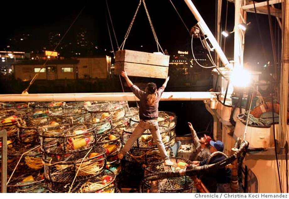 CHRISTINA KOCI HERNANDEZ/CHRONICLE  Fishermen at Fisherman's Wharf, in SF, including Sonny Held, ready their traps for crabbing, after end of strike. Photo: CHRISTINA KOCI HERNANDEZ