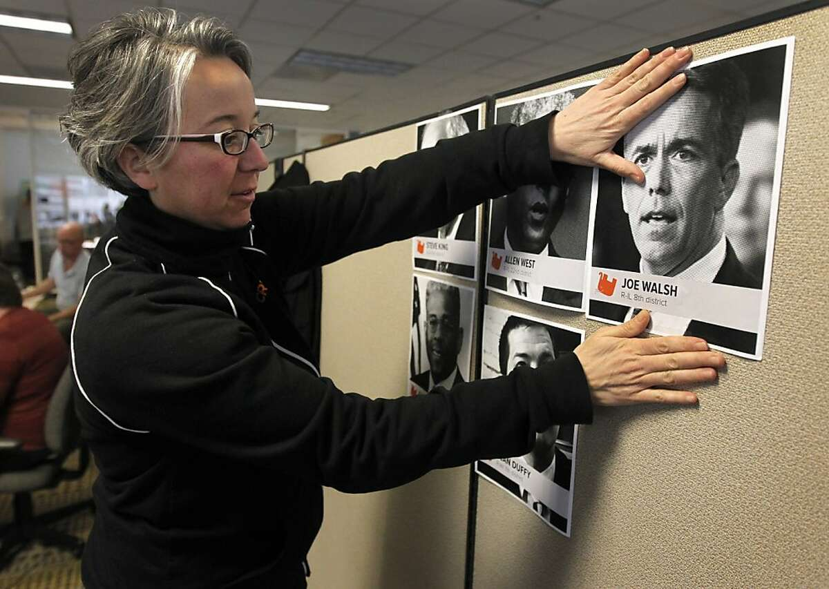 Becky Bond posts photos of Tea Party congressional members in Credo Mobile's super PAC nerve center in San Francisco on Friday. Bond is the political director of the telecommunication firm's newly-formed political action committee which is taking aim at several Tea Party politicians.