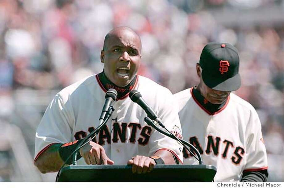 Barry Bonds while accepting his National MVP award promises fans that he will be back. Manager Felipe Alou behind. Opening day of the 2005 baseball season for the San Francisco Giants. The Giants take on the Los Angeles Dodgers. 4/5/05 San Francisco, Ca Michael Macor / San Francisco Chronicle Photo: Michael Macor