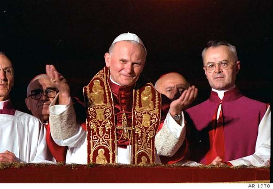 Pope John Paul II blesses the faithful in St. Peter's Square from a Vatican City balcony after he was named Pontiff, October 22, 1978. He became the third leader of the Roman Catholic Church in 1978. He is the immediate successor, of John Paul I, who was on the papal throne for only 33 days when he died. Paul VI was Pope until his death in August 1978. (AP Photo )