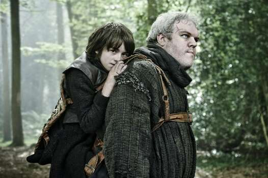 Kristian Nairn as Hordor and Isaac Hempstead-Wright as Bran Stark.