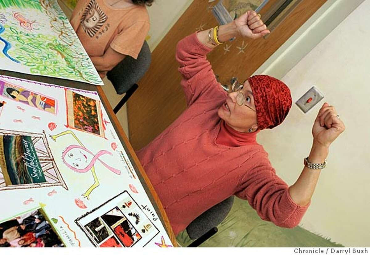 Carmen Qui�ones explains the theme of her painting, how she felt after finishing chemotherapy, at �Art for Healing� at the California Cancer Care Center. Chronicle photo by Darryl Bush