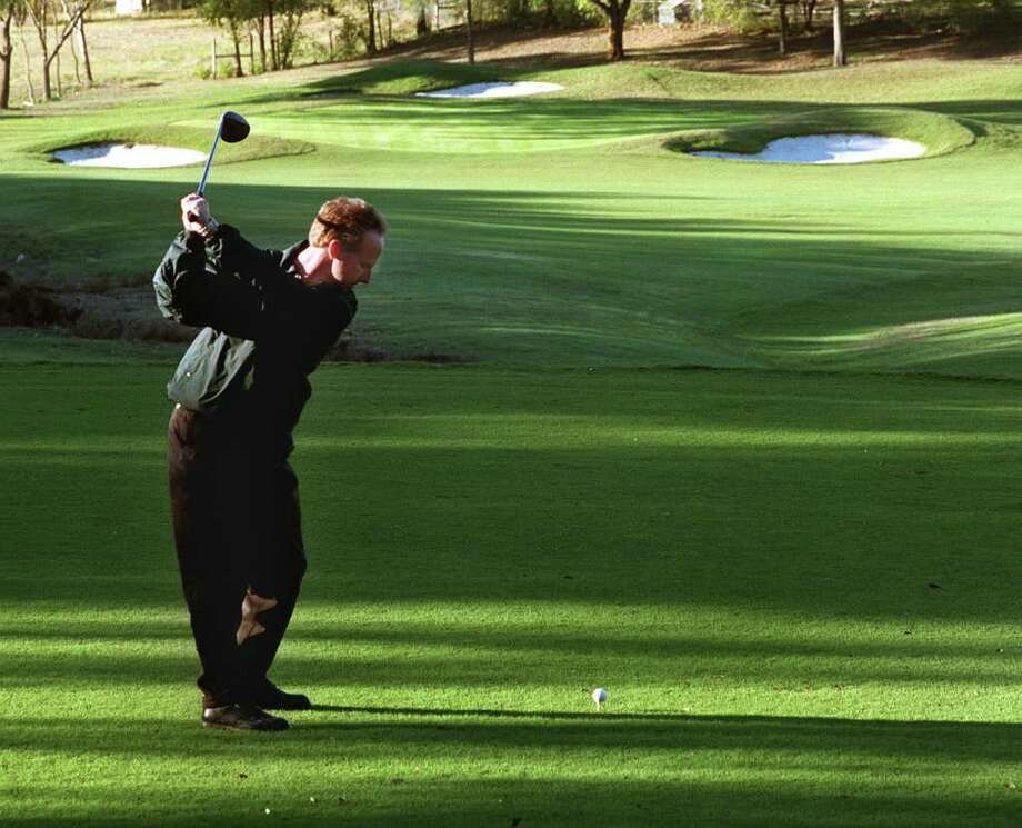 Van Gardner tees off at the Pecan Valley golf course in 1999 when the course underwent a $5.5 million renovation. Express-News file photo Photo: Charles Barksdale, EXPRESS-NEWS FILE PHOTO / CHARLES BARKSDALE