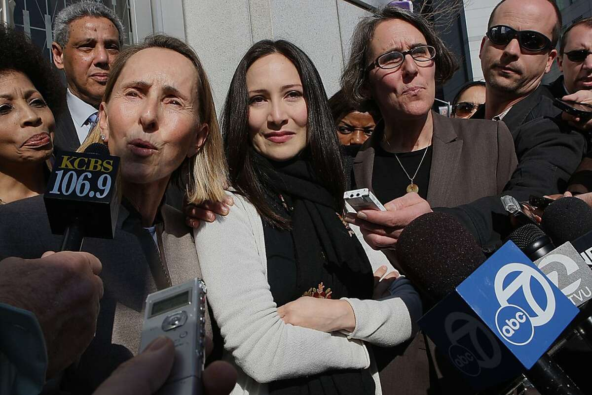 Eliana Lopez (middle) flanked by Paula Canny (left) and Deborah Wald (right) after the court hearing in San Francisco, Calif., which granted her husband, SF county sheriff Ross Mirkarimi, 22 hours of visitation rights a week to be with his two year old son on Wednesday, February 8, 2012.