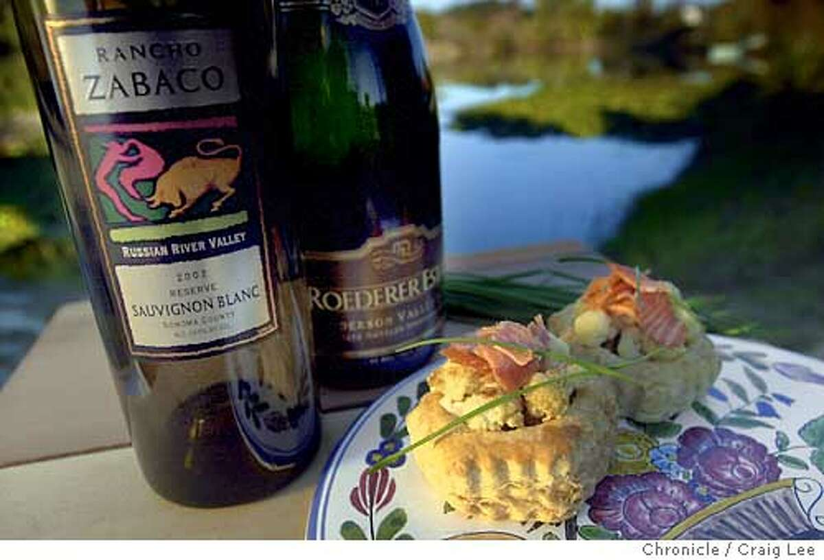 For Sunday Magazine Top 100 Wines issue. Photo of cauliflower, goat cheese and lox dish with bottles of Roederer Estate Anderson Valley Brut sparkling wine and Zabaco Russian River Valley Reserve Sauvignon Blanc. Photo was taken on location at Quintessa vinyards. Food photo styled by Noel Advincula. Event on 10/24/03 in Rutherford. CRAIG LEE / The Chronicle