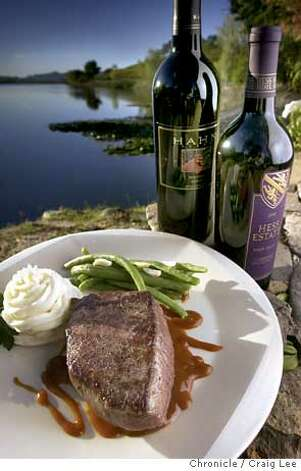 For Sunday magazine Top 100 Wines issue. Photo of beef filet with sauce with bottles of Hess Estate Napa Valley Cabernet Sauvignon and Hahn Monterey Merlot wines. Photo was taken on location at Quintessa vineyards in Rutherford. Food photo styled by Noel Advincula.  Event on 10/24/03 in Rutherford.  CRAIG LEE / The Chronicle Photo: CRAIG LEE