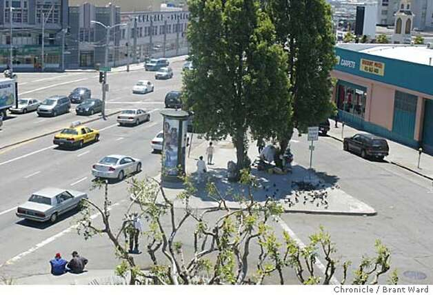 "ISLAND. Homeless series. A traffic island at the corner of South Van Ness Avenue and 12th Street in San Francisco is home to about a dozen homeless people who use the proximity to the freeway to ""sign"" or panhandle. Here is an aerial view of the ""island"" taken from the Honda dealership nearby. BRANT WARD / The Chronicle Photo: BRANT WARD"