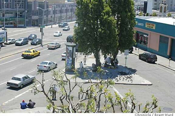 """ISLAND. Homeless series. A traffic island at the corner of South Van Ness Avenue and 12th Street in San Francisco is home to about a dozen homeless people who use the proximity to the freeway to """"sign"""" or panhandle. Here is an aerial view of the """"island"""" taken from the Honda dealership nearby. BRANT WARD / The Chronicle"""