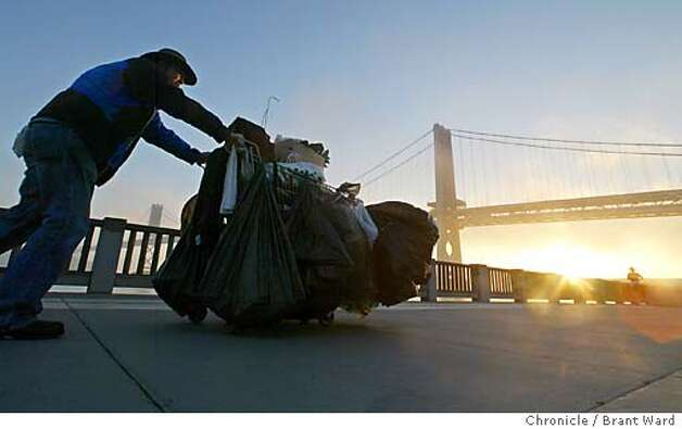 As the day broke on the San Francisco bay, John Stevens pushed his cart up the Embarcadero on the way to the recycling center. Stevens has been homeless for 13 years in the city, making ends meet by doing recycling. BRANT WARD / The Chronicle Photo: BRANT WARD