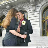 Janet Thomson (CQ) left, and Jamye Ford pause for a moment outside city hall after their wedding on Wednesday. They had just finished having a toast with some friends. They are from San Francisco.  Same-sex marriages continue at city hall, with lines outside and inside. Event on 2/19/04 in San Francisco. LIZ MANGELSDORF / San Francisco Chronicle