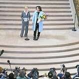 Rosie O'Donnell and her longtime partner Kelli Carpenter (over her right shoulder) leave city hall after their marriage. San Francisco city treasurer Susan Leal, far left (half face only) married them behind closed doors. a Same-sex weddings continue at city hall.  Event on 2/26/04 in San Francisco. LIZ MANGELSDORF / The Chronicle