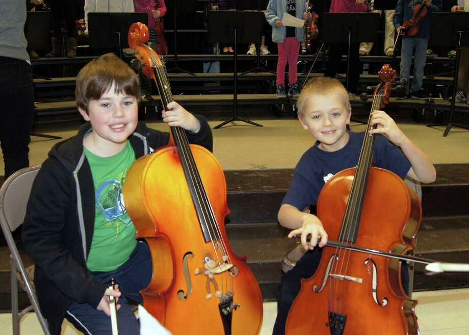 Ox Ridge third-graders Grant McIntyre and Ernst Bruno were among the ten cello players who performed in the Third Grade Winter Showcase strings concert. Photo: Contributed Photo
