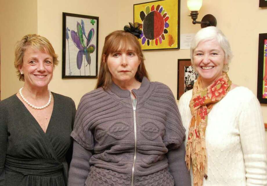 The Bank of New Canaan hosted a reception to kick off the Arts for Healing student exhibit that is on display at the Bank's Elm Street offices through the end of March. From left is Bank of New Canaan VP Gail Donovan, exhibiting artist Kathy Maher and Arts for Healing Director of Development Holly Lemoine. Photo: Contributed Photo