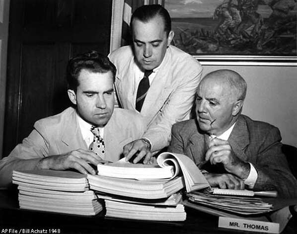 Rep. Richard Nixon, R-CA, investigator Robert Stripling, and Rep. J. Parnell Thomas, R-NJ, left to right, look over testimony in the House Un-American Activities committee spy inquiry August 26, 1948, preparatory to turning it over to the Justice Department. (AP Photo/Bill Achatz) Photo: BILL ACHATZ
